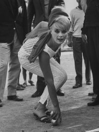 844001~Elke-Sommer-Playing-Petanque-at-the-Cannes-Film-Festival-Posters